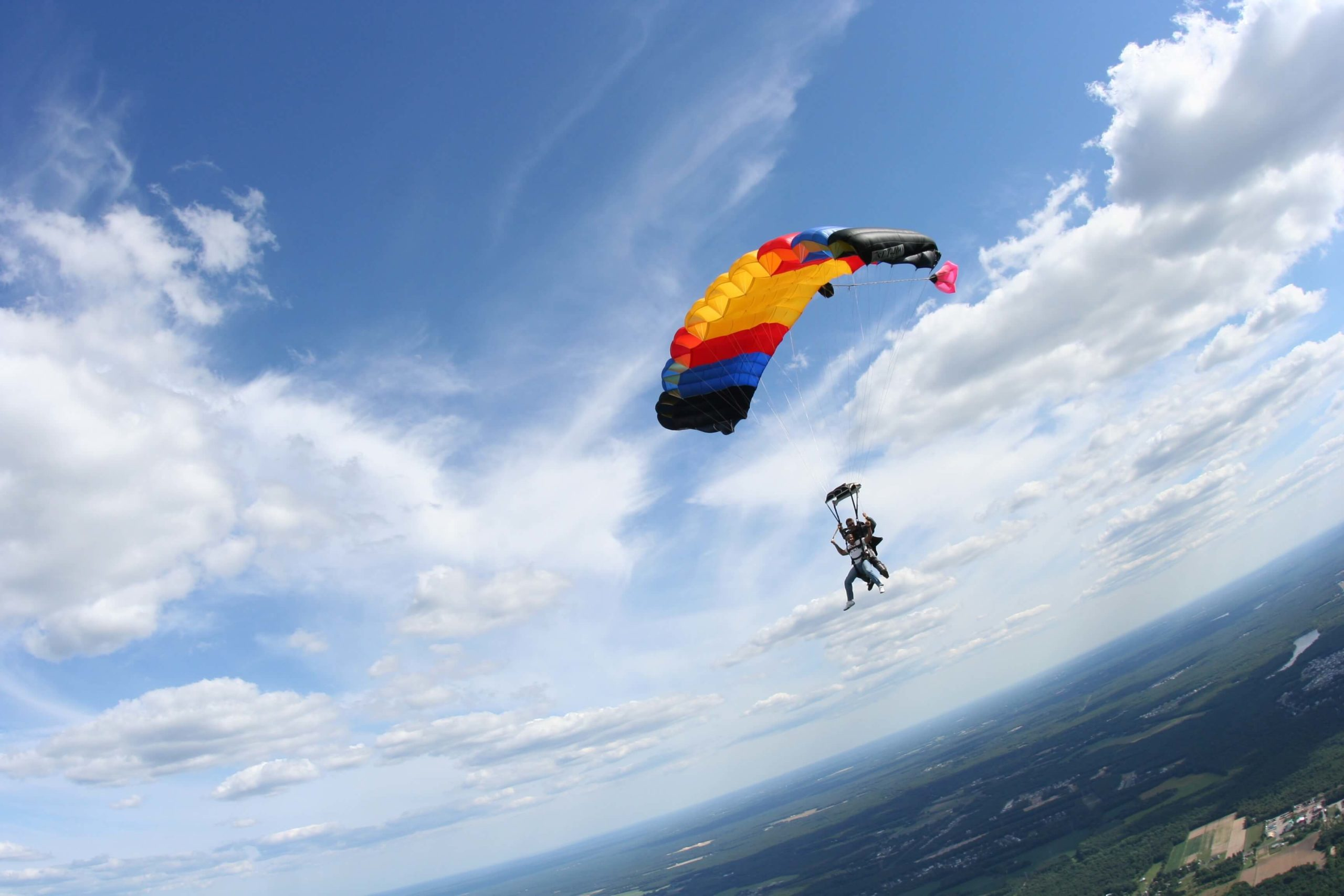 Tandem skydivers glide with the parachute.