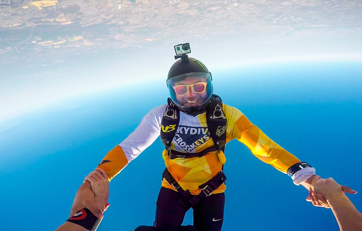 Skydiver floats upside down in the air.