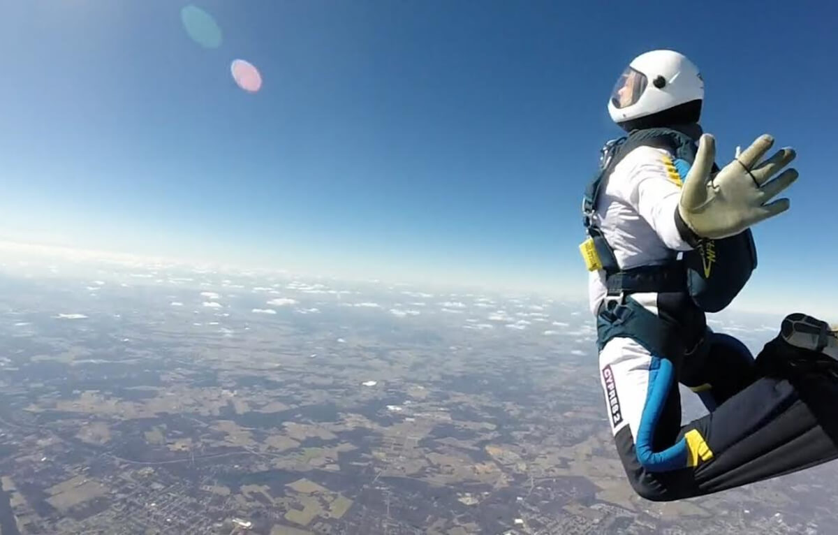skydiver floats mid-air.
