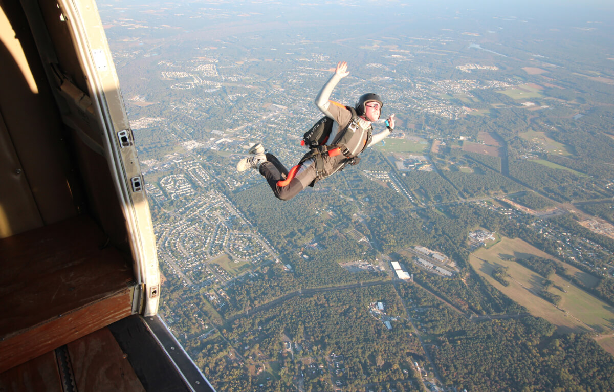 Skydiver jumps out the plane.