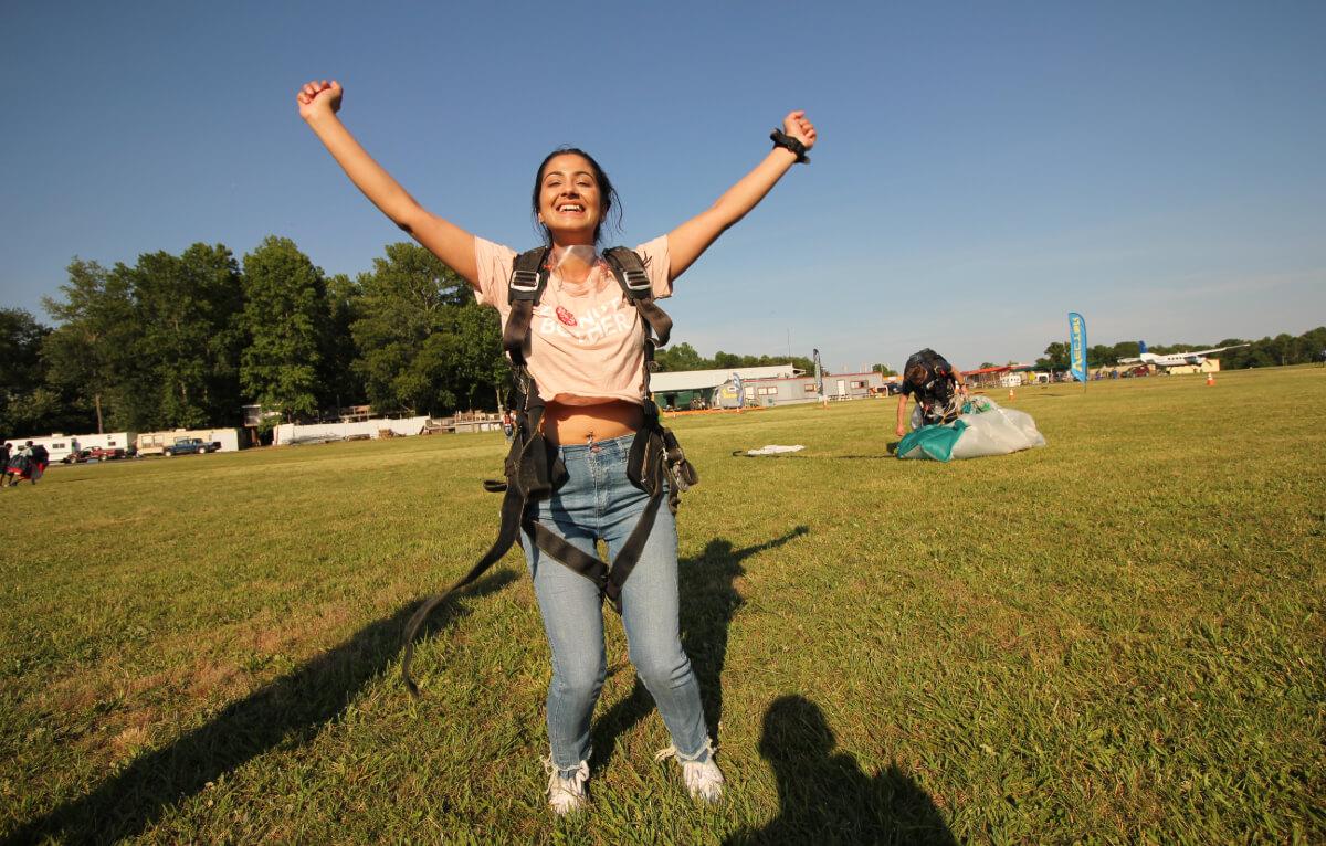 Girl jumps for joy post-jump.