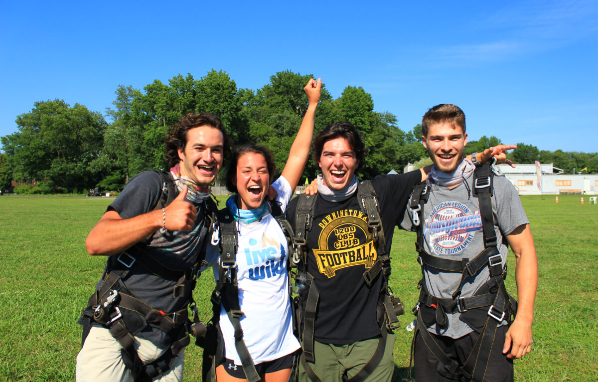 Friends cheer after skydiving.