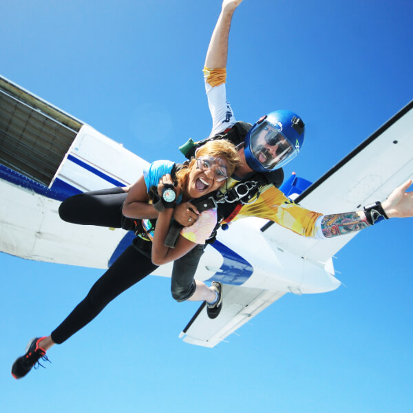 Tandem skydivers jump out the plane.